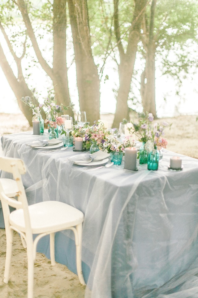 Soft blue tablscape with pink, teal and grey details