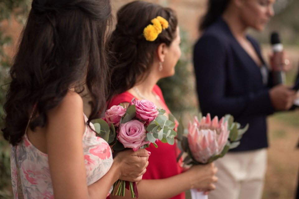 bridesmaids with mismatched bouquets and dresses