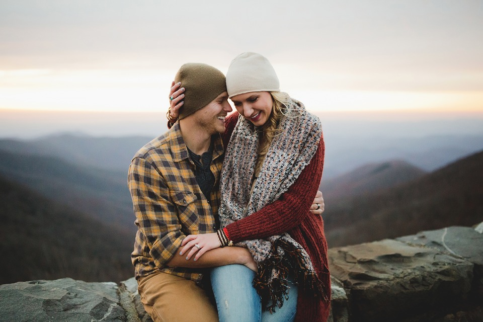 cozy mountain engagement couple