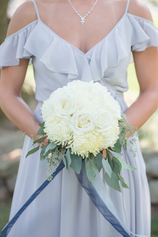 dusty blue bridesmaid dress with white bouquet