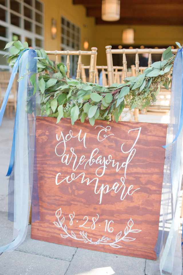 beyond compare wood wedding ceremony sign