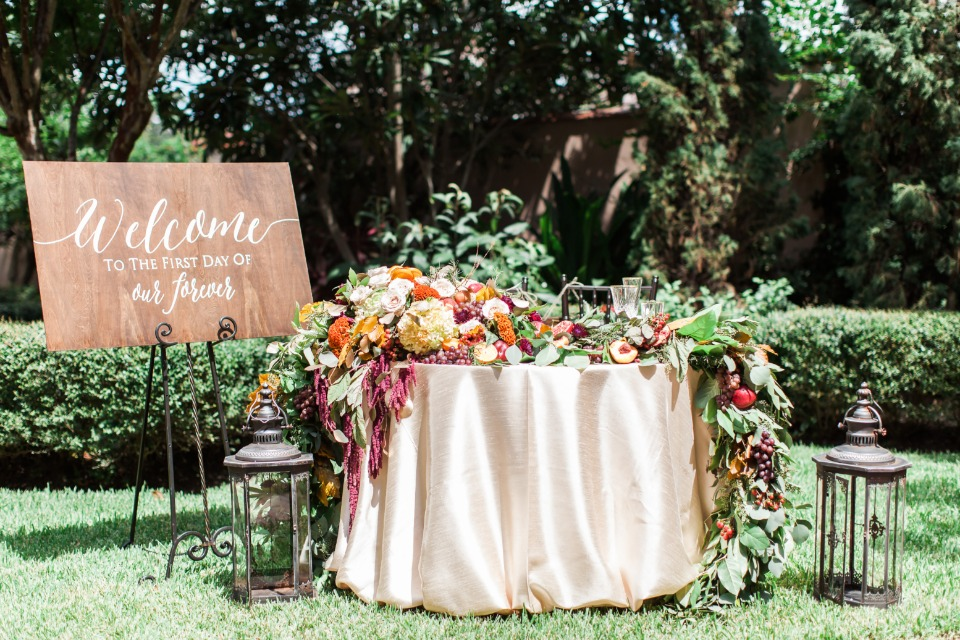 gold sweetheart table with cascading floral decor