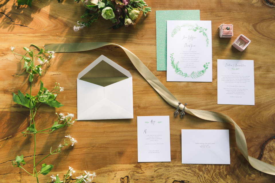 green and white wedding stationery