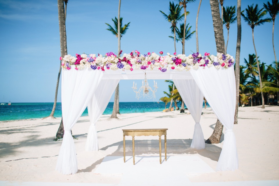white and pink beach ceremony