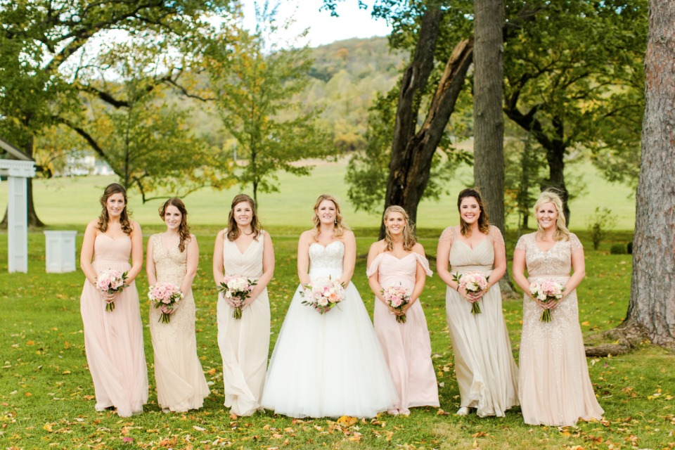 Bridesmaids in mismatched gowns