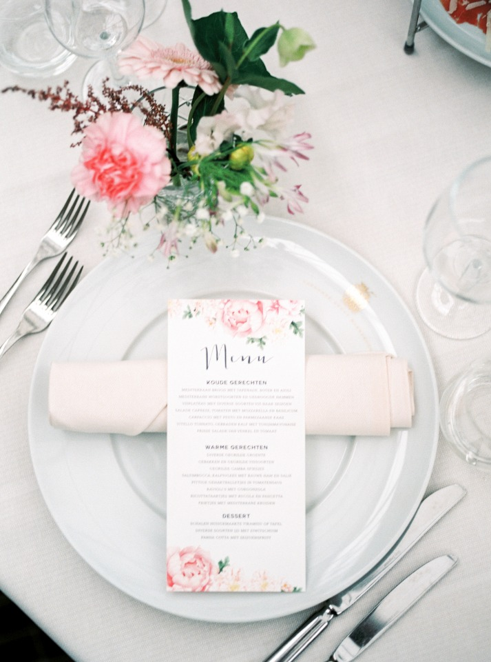 flower accented wedding menu and simple place setting