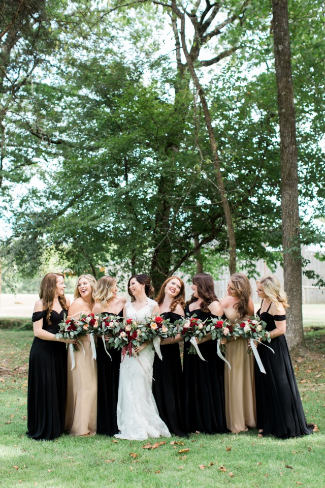 Bridesmaids in gold and black dresses