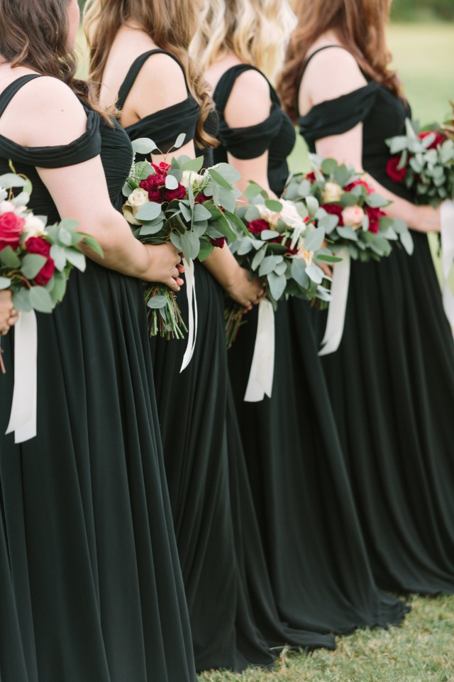 Bridesmaid in black and gold dresses