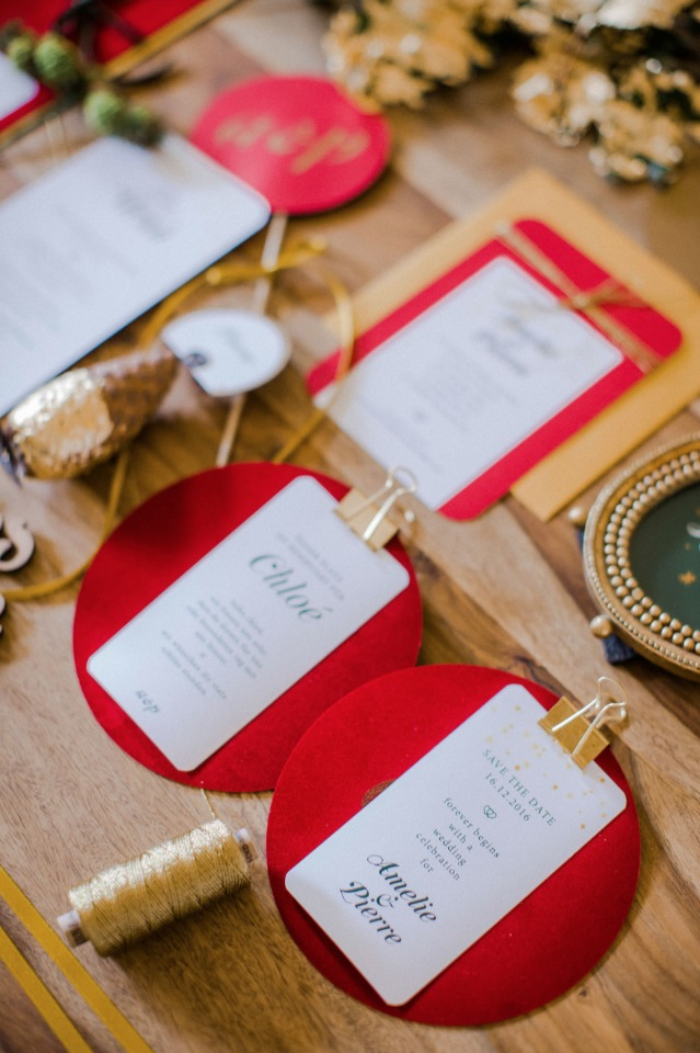 gold and red holiday themed wedding invitation suite