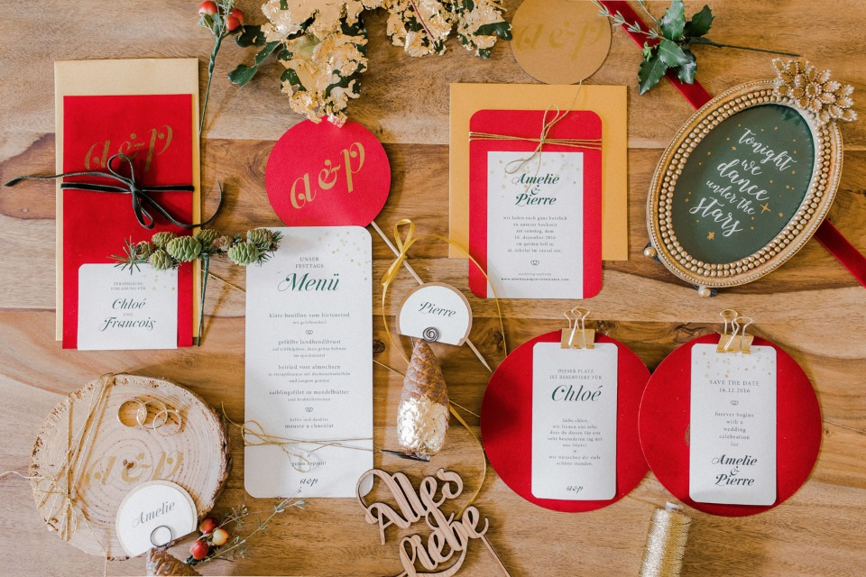 holiday themed wedding invitation suite in red and gold