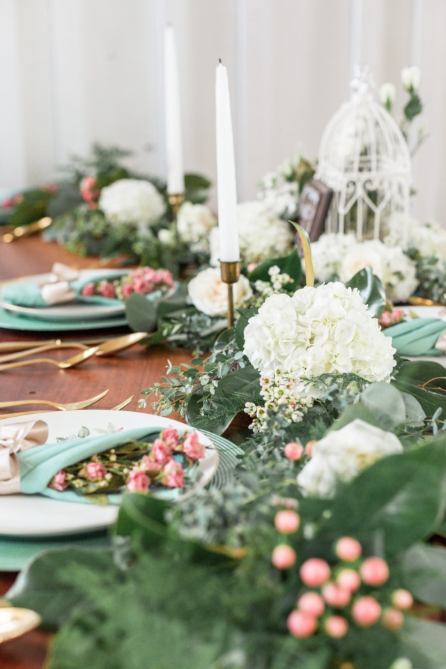 white pink and dark green wedding table