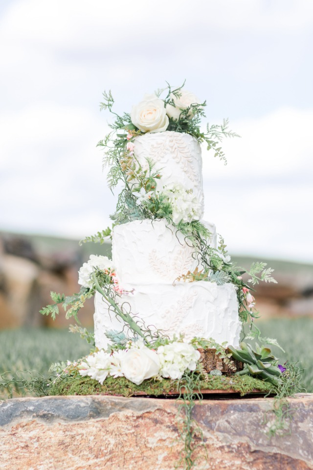 ivy climbing wedding cake topped with white roses