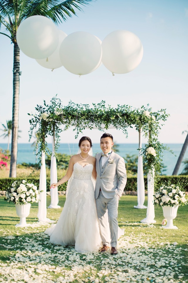 giant balloons over the floral wedding arch