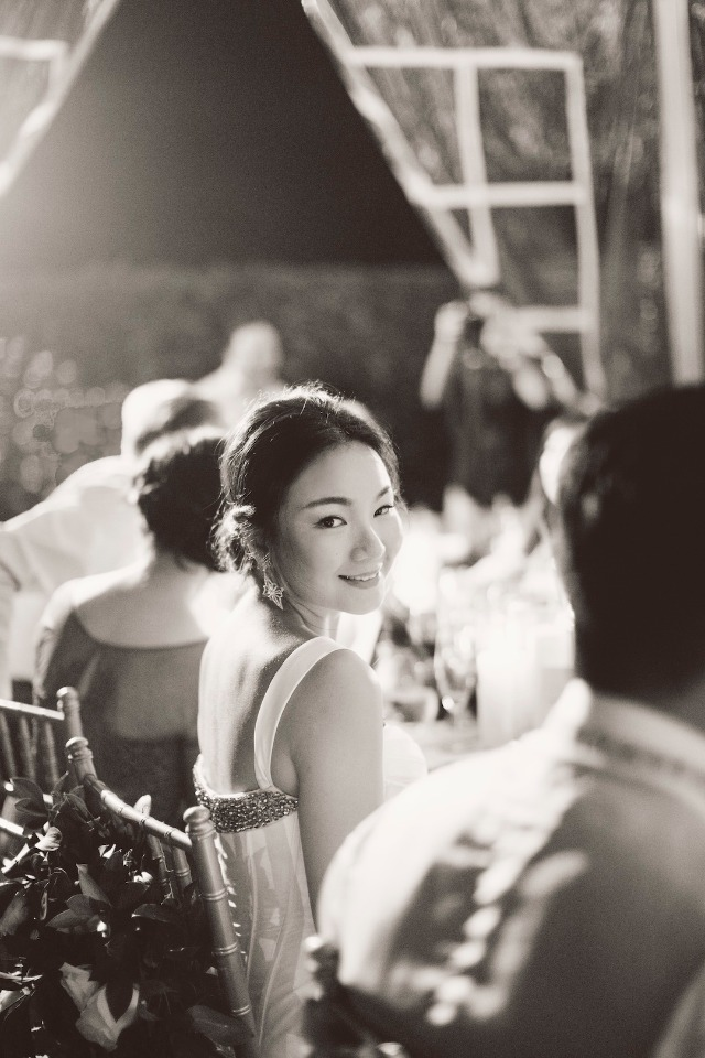 sweet candid shot of the bride at her reception