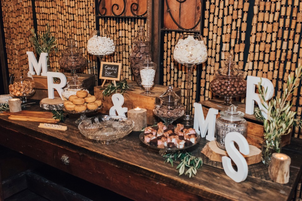 Mr and Mrs dessert table with wine cork backdrop