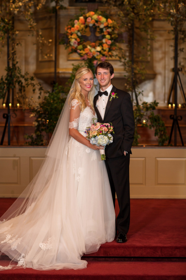 chapel wedding ceremony with floral background