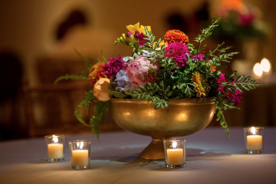 colorful flowers and gold wedding centerpiece