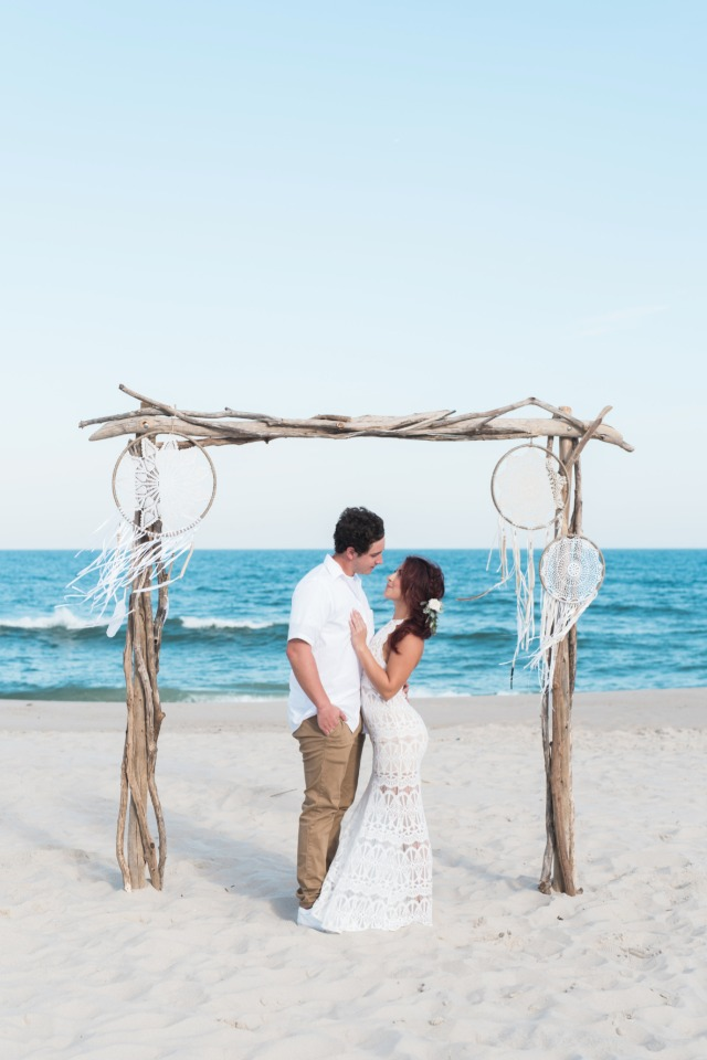 Beautiful boho beach wedding with driftwood arbor
