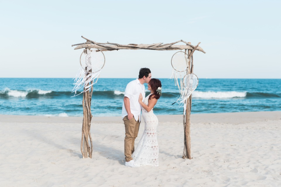 Gorgeous driftwood arbor with dream catchers