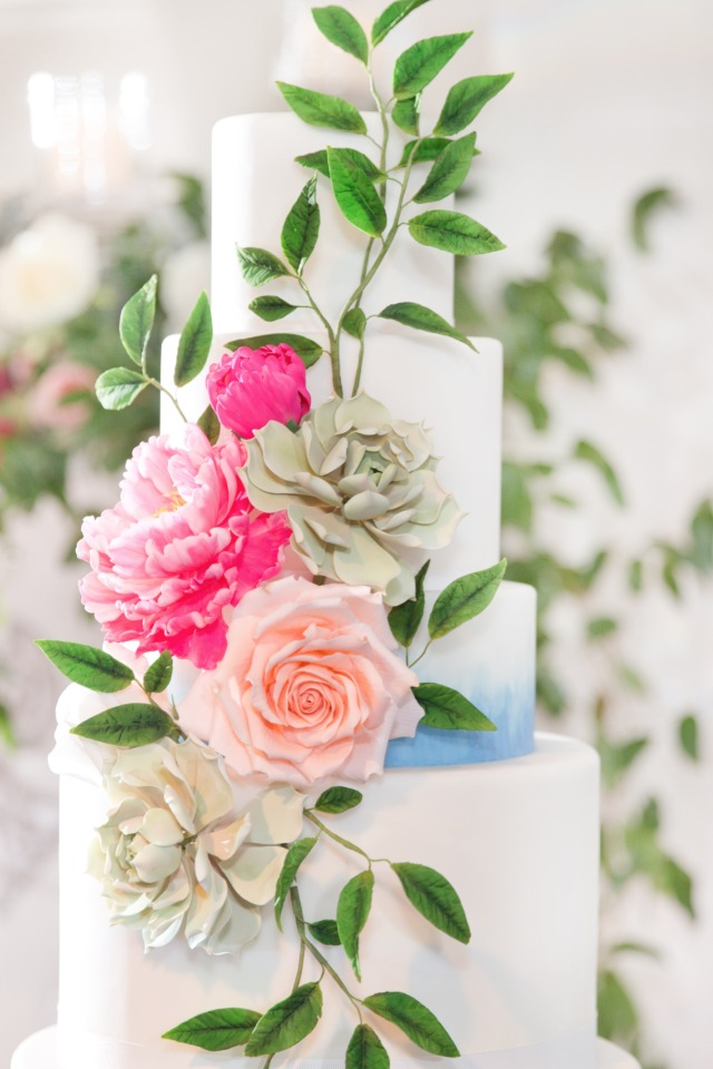 Blue watercolor cake with cascading florals