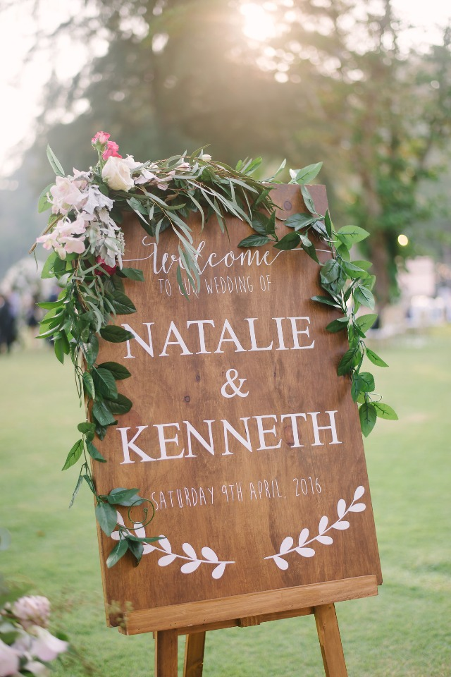 cute flower accented wedding sign