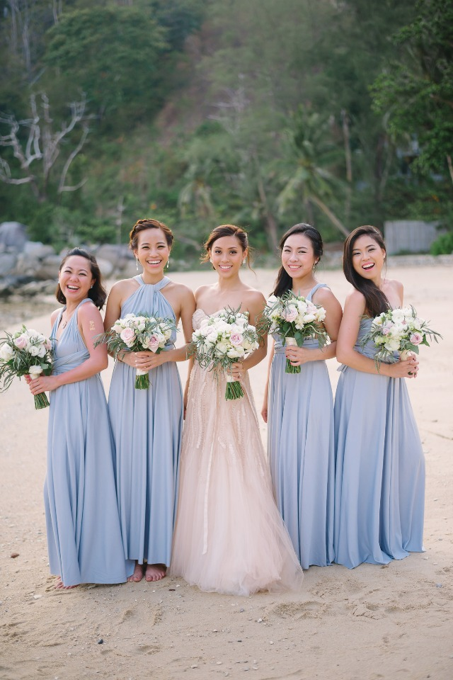 bridesmaids in periwinkle and bride in blush
