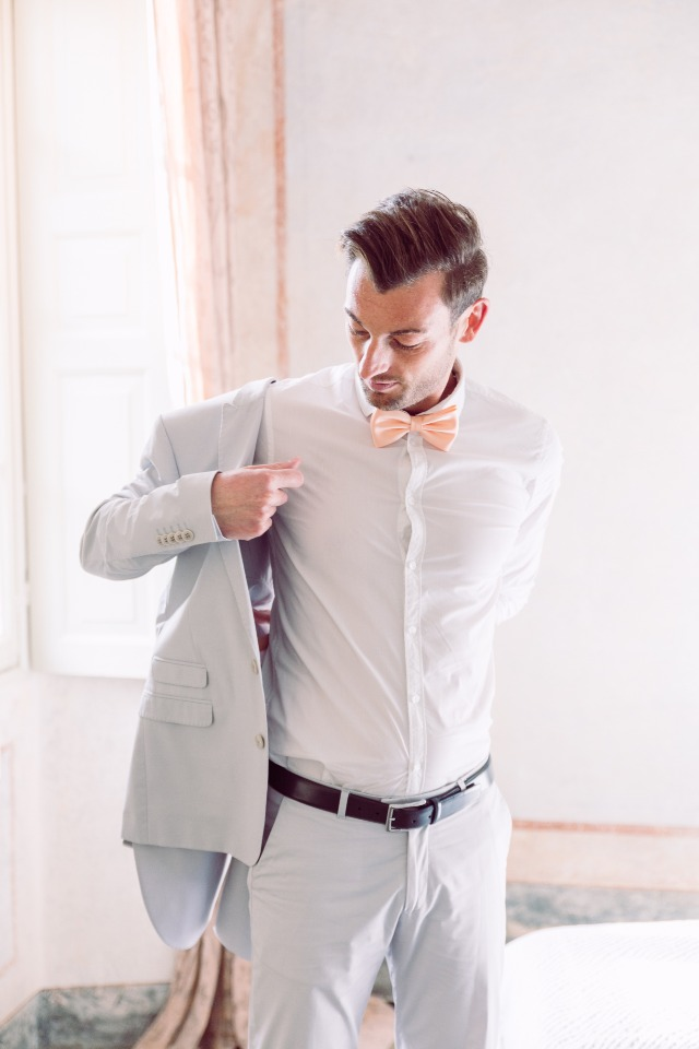 Groom getting ready for double wedding