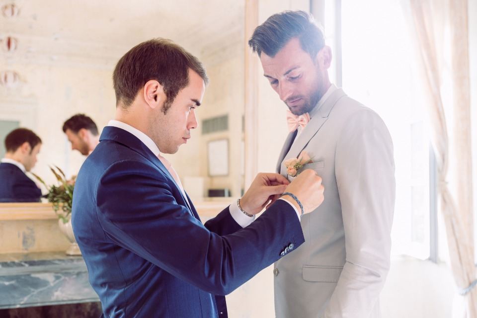 Grooms getting ready for double wedding