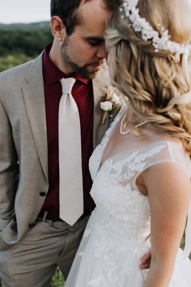 groom in grey suit and maroon shirt