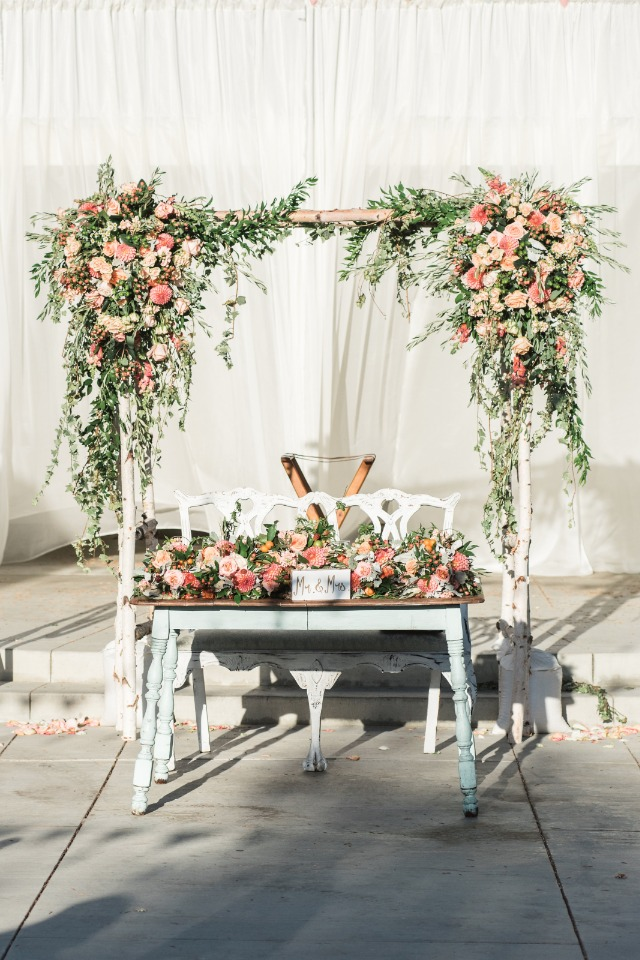 Use your wedding arbor for your sweetheart table backdrop