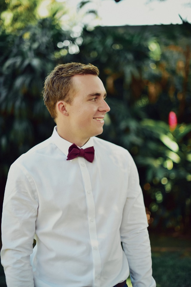 Groom with burgundy bowtie