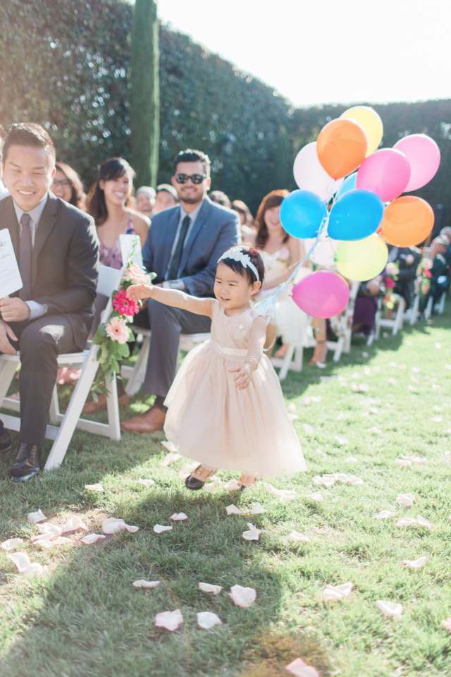 flower girl with balloons instead