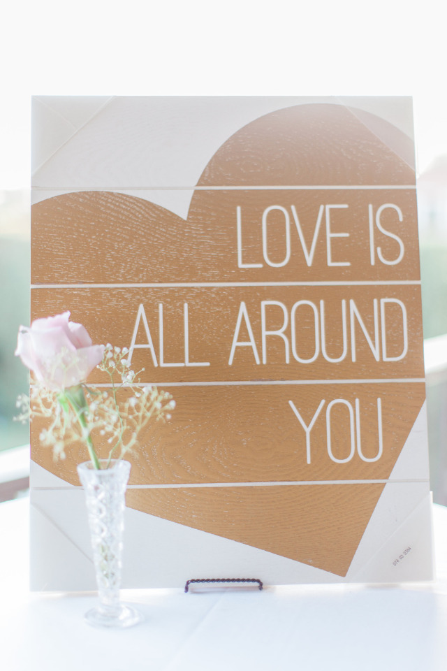 love is all around you wedding sign