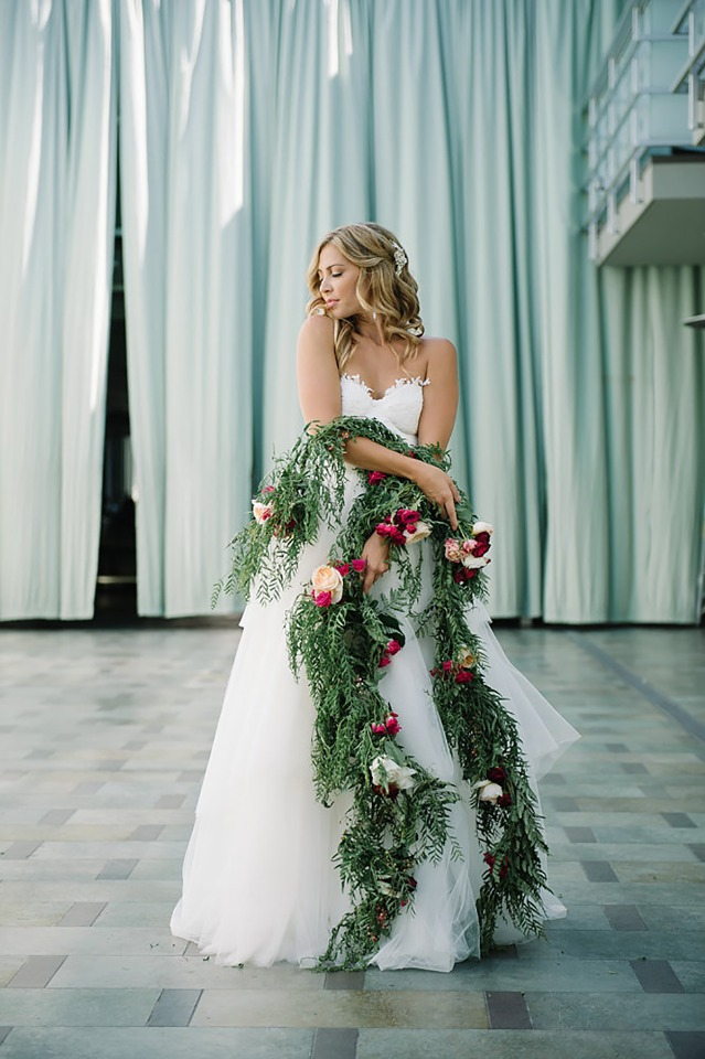 bride and a christmas garland