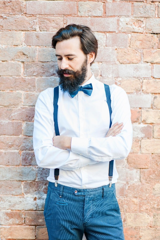 hipster groom in bow tie and suspenders