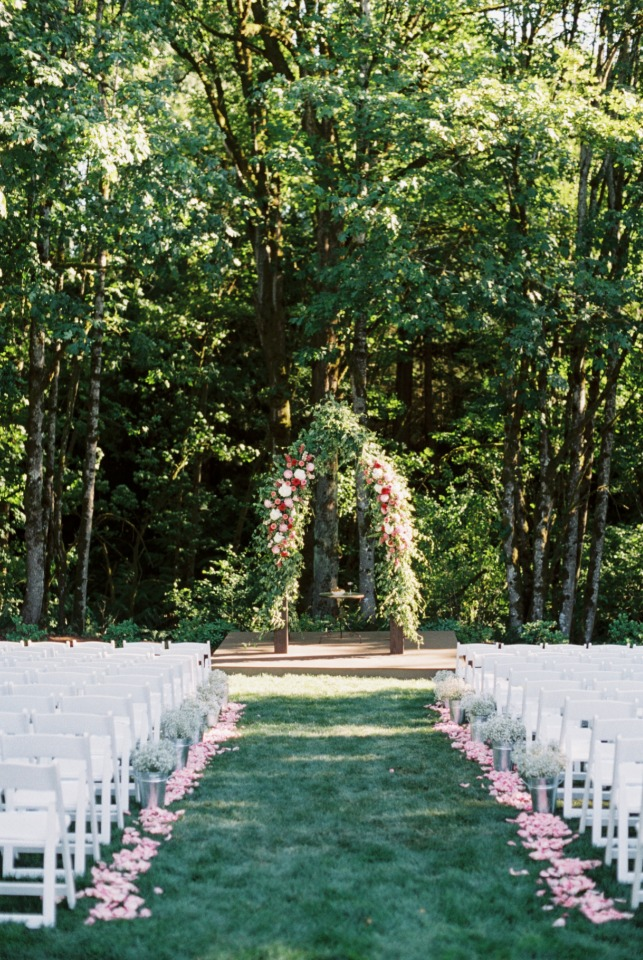 Floral filled wedding arbor