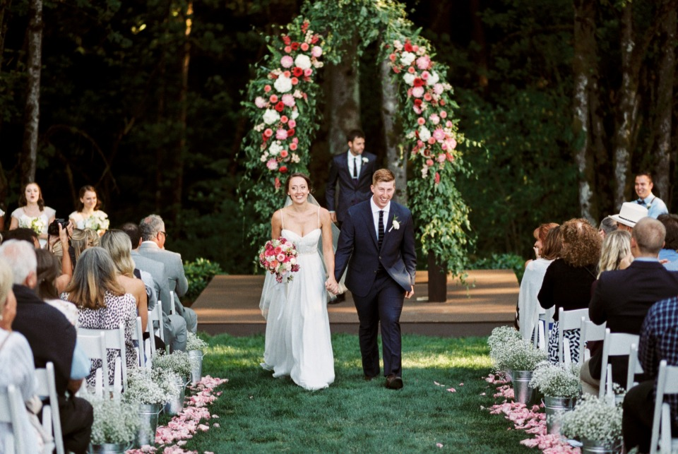 Look at that stunning wedding arbor!