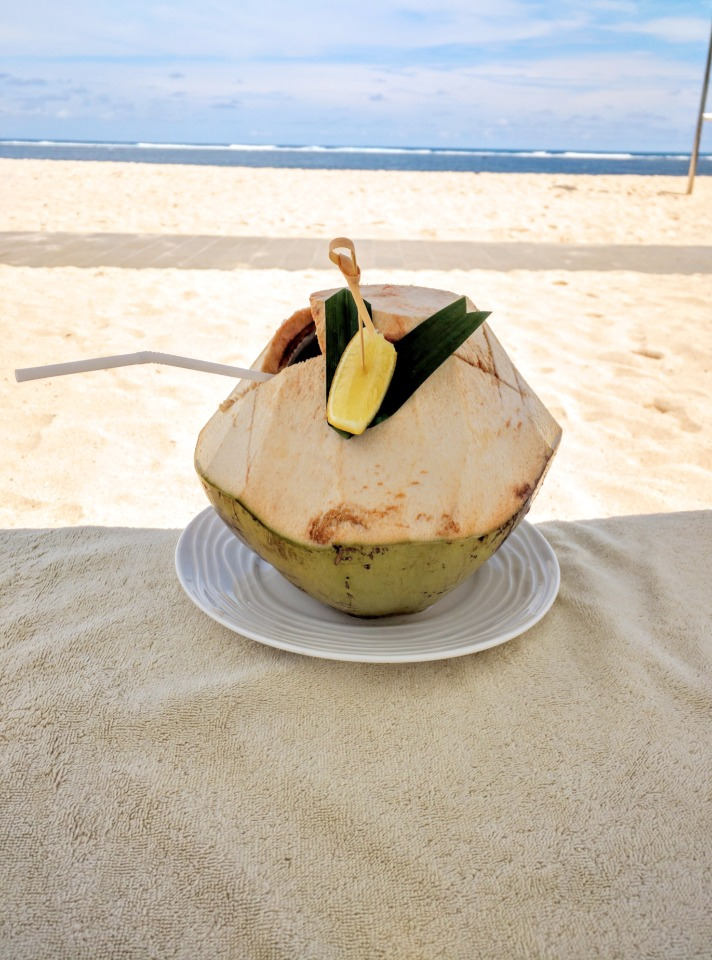Coconut drink on the beach in Bali at The Mulia Resort