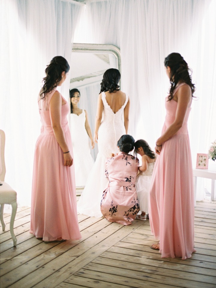 the bride and her bridesmaids in soft pink