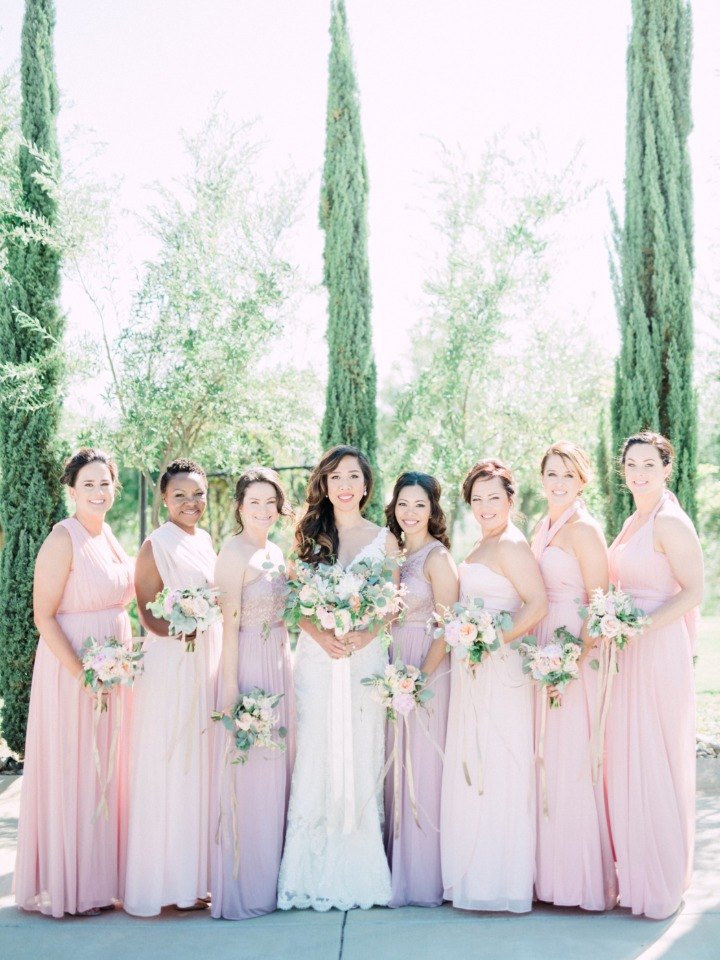 bridesmaids in long dresses of assorted pink colors