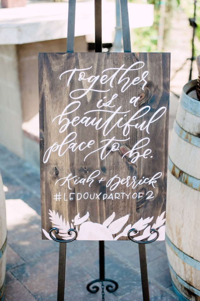 together is a beautiful place to be wedding sign