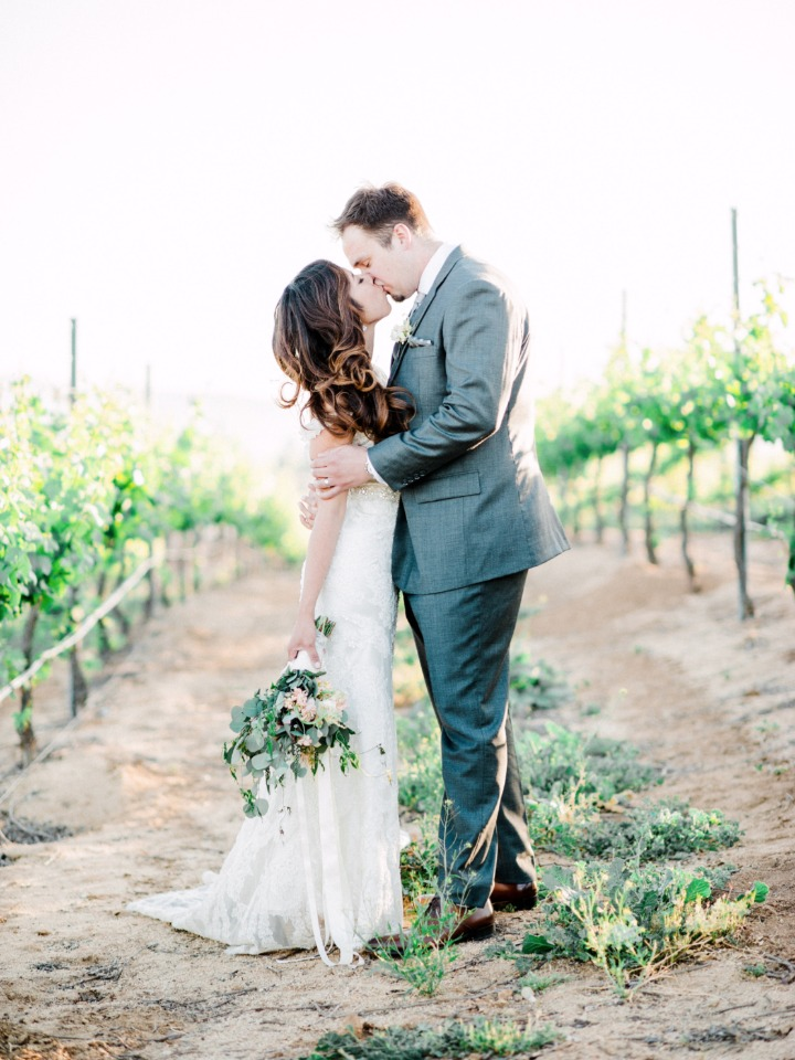 romantic vineyard wedding kiss