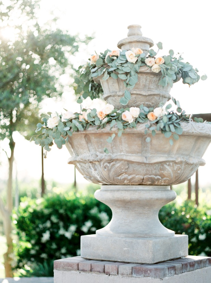 flower garland on wedding fountain