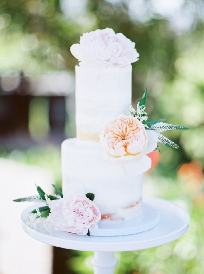 slim flower topped wedding cake