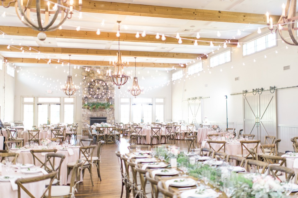 Natural white and green ceremony with bistro lights