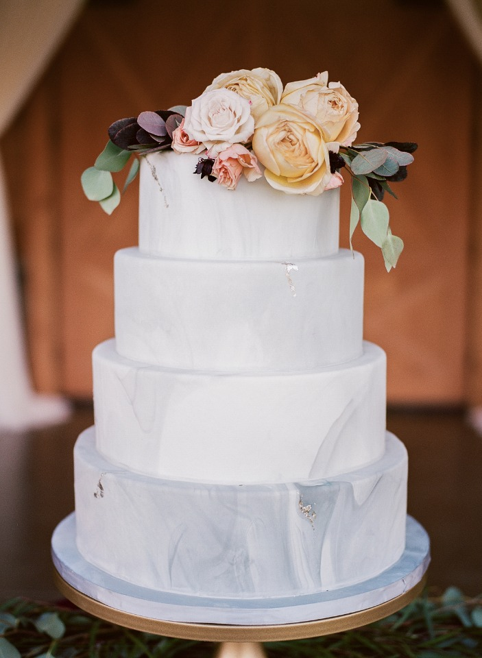 marble ombre wedding cake topped by roses