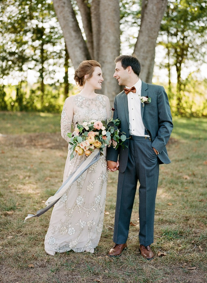 vintage style wedding dress and groom in bow tie and suit