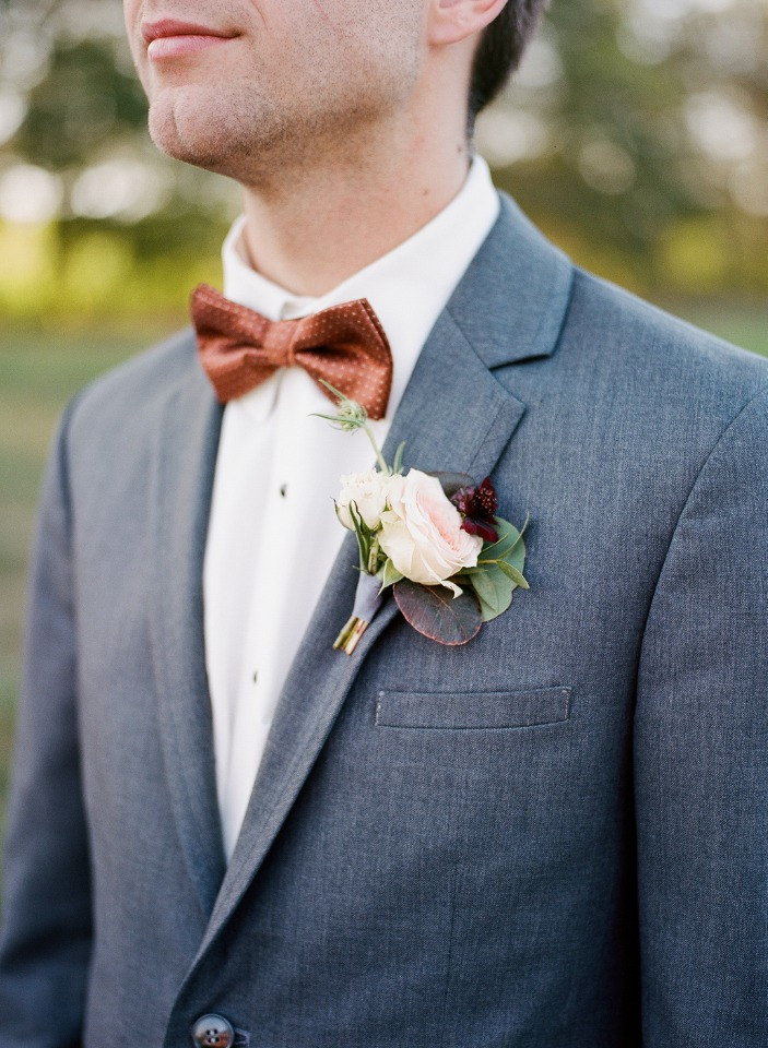 burnt orange bow tie and grey suit