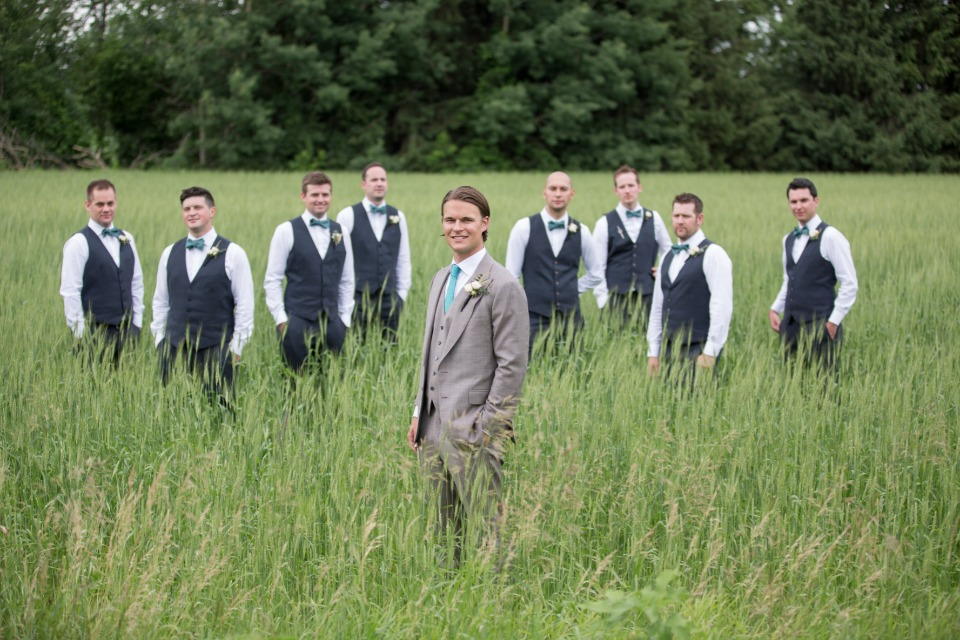 groom and his men in a field