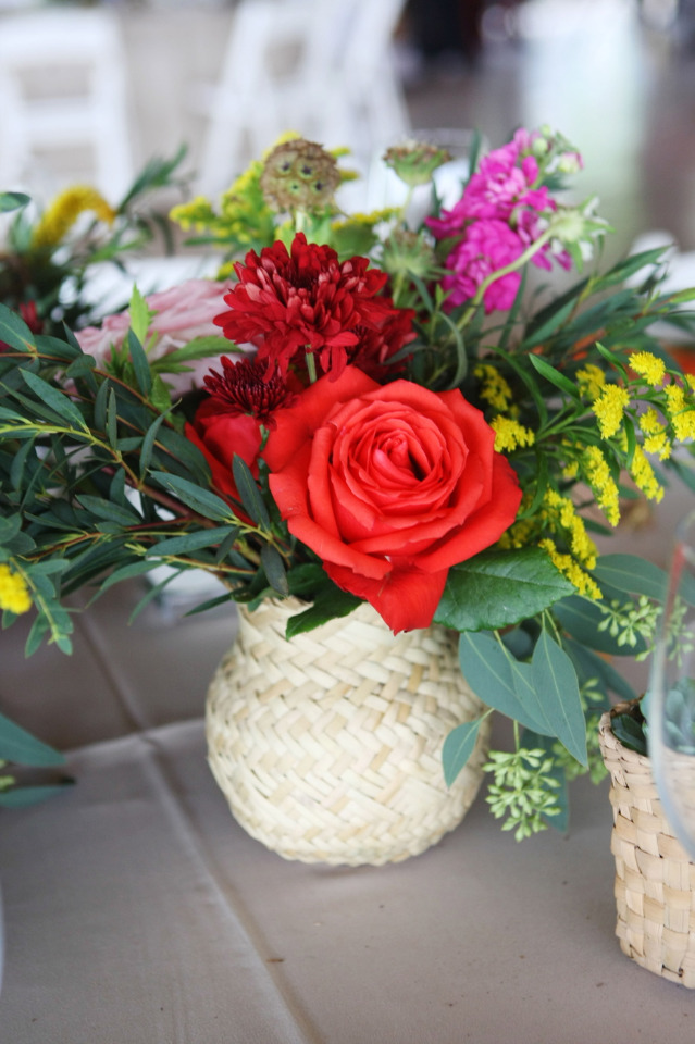 red yellow and purple wedding centerpiece